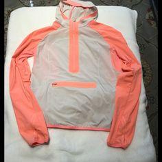 Lululemon stash and dash jacket Adorable like new lululemon stash and dash pullover jacket. Cute coral and beige colors size 8 no PP lululemon athletica Jackets & Coats