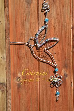 Coirnini© New Hummingbird. Artistically created with intricate wire and accented with whimsical wire charms and a splash of coloured beads. Hang