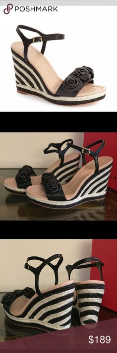 "Kate Spade jill rosette espadrille platform sandal With a striped espadrille wedge heel and rosette-embellished toe strap, this contemporary style is sure to turn heads. Open toe. Triple floral vamp detail. Ankle buckle strap closure. Lightly padded insole. Espadrille midsole detail. Approx. 4.5"" heel, 0.75"" platform. Leather upper, lining and sole. kate spade Shoes Espadrilles"
