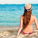 Como proteger os cabelos dos efeitos da praia e sol