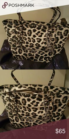 Guess purse This is an original Guess purse with black Leopard print. New with tags never used. Guess Bags Shoulder Bags