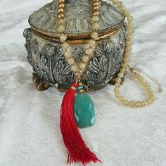 "Tassel Necklace Brand new with out tags. Never worn. Beautiful combination of gold toned beads, turquoise stone & red tassel. 36"" necklace with 3"" extender. Jewelry Necklaces"