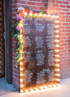 Wooden wedding reception seating chart framed with light bulbs - Photographer: Elisabeth Arin Photography; Reception Seating Chart, Wedding Reception Seating, Marquee Wedding, Seating Chart Wedding, Wedding Signage, Wedding Table Numbers, Blackboard Wedding, Wedding Table Assignments, Mirror Seating Chart