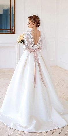 There are some exciting new trends in the 2020 wedding gown collections. From interesting necklines to daring skirts (slits!) to elegant cover ups, brides will have many gorgeous styles from which … A Line Bridal Gowns, Bridal Dresses, Wedding Gowns, Ball Dresses, Ball Gowns, Popular Wedding Dresses, Trendy Wedding, Wedding Dress Silhouette, Brides