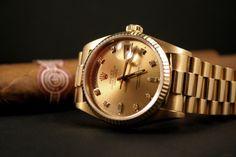 Rolex, men's luxury watch.