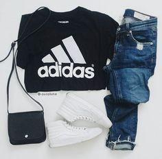 Black adidas shirt, blue jeans, white sk8 hi vans