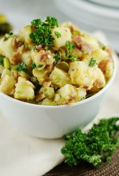 Vinegar-based German Potato Salad with Bacon ~ it's great served both warm or chilled.