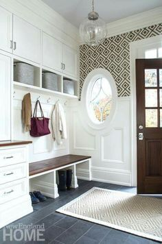 This is a pretty entryway inspiration - bold wallpaper with a gray tile floor - would be pretty to paint the inside of your front door
