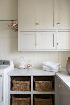 Woven wicker baskets perfectly fitted in four open shelves under a honed marble countertop in a white and gray laundry room. Woven wicker baskets perfectly fitted in four open shelves under a honed marble countertop in a white and gray laundry room. Laundry Room Cabinets, Laundry Room Organization, Laundry Room Design, Diy Cabinets, Laundry Shelves, Laundry Storage, Room Shelves, Small Shelves, Laundry Hamper