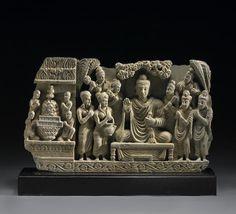 "A gray schist architectural frieze Gandharan Era, 2nd/3rd Century CE 11-3/8""x18-3/4"" USD 19,520"