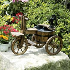 Solar Powered Wooden Tricycle With Barrel And Pump Garden Water Feature: Amazon.co.uk - £99.99