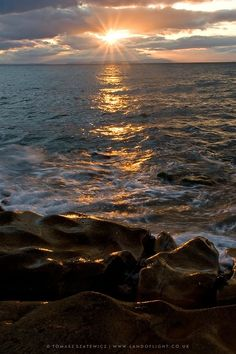 Setting Sun at Burghead, Moray Firth, Scotland.
