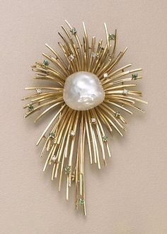 A cultured pearl, diamond and emerald brooch of abstract design - circa 1940