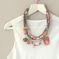 Textile Statement Necklace – Tribal African Fabric Necklace / Pink and Gray Cotton Layered by ATLIART on Etsy https://www.etsy.com/listing/129626181/textile-statement-necklace-tribal
