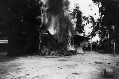 A burning building during a silent film shoot at what used to be the Bonadiman farm in Edendale, located near what is now Benton Way in Silver Lake. Photo circa 1915. (LAPL) Bizarre Los Angeles.