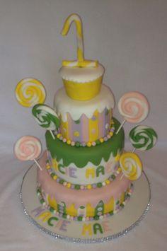 An elaborate colourful first birthday cake
