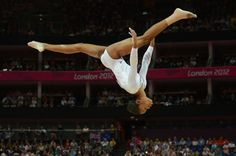 U.S. gymnast Gabby Douglas tumbles over the balance beam during women's gymnastics event finals at the London Olympics.