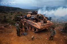 American soldiers look through and stand around a Sheridan tank atop a hill during Operation Dewey Canyon II/Lam Son which is aimed to reopen and secure Route 9 and reoccupy Khe Sanh as a forward supply base. Vietnam History, Vietnam War Photos, North Vietnam, Vietnam Veterans, Marie Curie, Mahatma Gandhi, Sheridan Tank, Armored Fighting Vehicle, Military Modelling