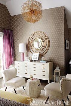 Master bedroom. White dresser with round mirror.