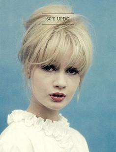 60s style updo with bangs and heavy eyeliner