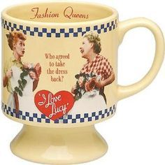 12 oz. decal mug. On the inside it says Fashion Queens. On the front it says - Who agreed to take the dress back? And on the back it says - Both agreed but both secretly kept it.