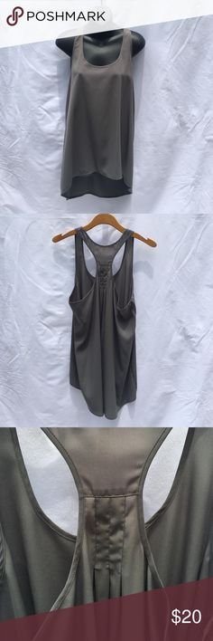 """{Urban Outfitters} frenchi Gray Silky Racerback This is frenchi brand from Urban Outfitters. It is a gray gorgeous tank, Racerback, with a high/low hem. It is approximately 27"""" from shoulder to hem in the front and about 33"""" in length in the back. It is about 20"""" bust from underarm seam to underarm seam. Very flowy and beautiful layered or worn alone! Frenchi Tops"""