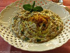 Eggplant and Yogurt Dip    Mast-o-bademjan/ Borani bademjan (eggplant and yogurt dip) is a very delicious appetizer especially for eggplant lovers. Also, if you enjoy the taste of garlic, this is a kind of dish that you may use as many garlic cloves as you like!