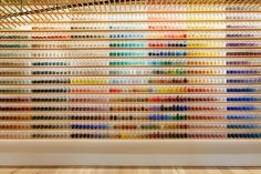 Thousands of pigments fill glass vials below the slatted wood ceilings of the new concept Pigment, an art supply laboratory and store that just opened in Tokyo by company Warehouse TERRADA. The store design was created by architect Kengo Kuma, utilizing bamboo and large open spaces to create a s