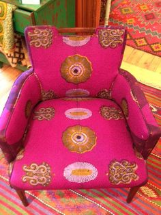 Mid century club chairs reupholstered in purple african wax print fabrics. $595.00, via Etsy.