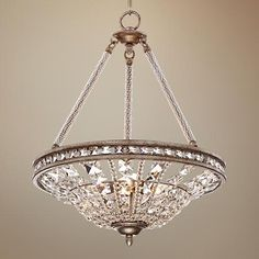 Antique silver leaf finish is an elegant pairing to the clear crystal in this entryway pendant.