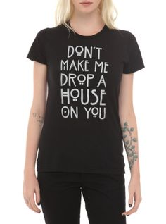 "Fitted black tee from American Horror Story: Coven with text design that reads ""Don't Make Me Drop A House On You."""