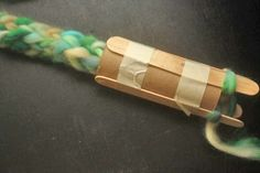 Pass on your old love of spool and finger knitting to your own kiddos with this easy DIY spool knitter!