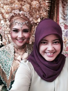 "One of my best friend. She is so gorgeous on her wedding. She is wearing ""suntiang"".."