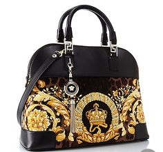 """This beautiful Versace purse is called """"Vanitas"""" Athena Velvet Handbag. The soft velvet is paired with a baroque print. It costs $2,540."""