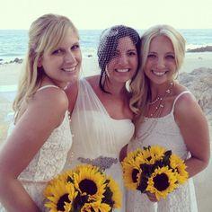 White beach wedding! Sunflower bouquets. <3