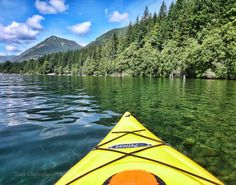 Kayaking in  British Columbia 11 x 14 inch Fine Art Print Photo British Columbia Victoria Mountain yellow boat water lake sport on Etsy, $39.63 CAD