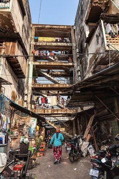 Dilapidated: When the White Building was first built in Cambodia's Phnom Peng slum, it was hailed as the pinnacle of modern living - but today is little more than a crumbling ruin, where people fear the next crack could be the one which brings it all crashing to the ground