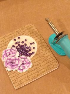 Shaker card made with WRMK Fuse Tool.  Stampin Up background stamp & flower stamp