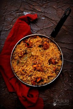 Chicken Tikka Biryani - Smoky flavored spicy chicken chunks in sizzling biryani. a delectable twist to the famous Indian dish.