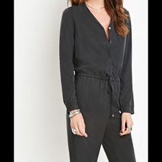Drawstring Utility Jumpsuit A long-sleeved utility jumpsuit complete with a partially buttoned front placket, a drawstring waist, and slanted front pockets. Forever 21 Pants Jumpsuits & Rompers