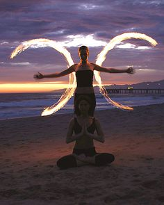 Fire Poi. (the fire outline reminds me of the Goddess/Triple moon crescent) Beautiful pic.