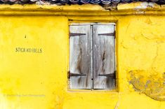 Yellow wall and wooden window