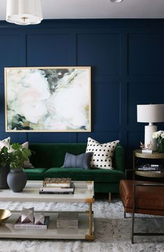 Stunning dark blue wall trimmed out with paneling in this formal sitting room // studio-mcgee.com