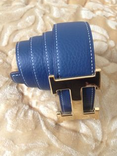 •    Style: Belt •    Brand : Hermes •    Color : blue on one and Black on          the other side with 3 holes •    Material : Leather •    Buckle :  Smooth Gold buckle   for more information contact me @: siham.payeb@gmail.com