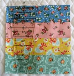 I love the Dresden Plate block but never thought of using it with strips of fabric - GREAT idea!