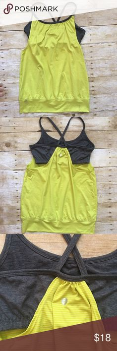 SOYBU Green and Grey Workout Tank Look and feel stunning while you work out or do yoga in this cute top! Features a built in bra, criss cross back! Soybu Tops Tank Tops