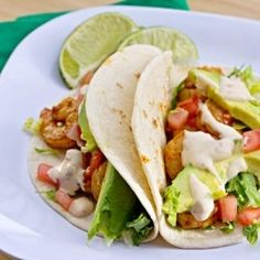 Baja Shrimp Tacos with tomatoes, cabbage, sliced avocado and a spicy chipotle lime sauce