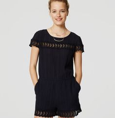 """Take a femme approach to beach days with this easy romper, trimmed in the prettiest lace. Round neck. Short sleeves. Elasticized waist. Front slash pockets. Button keyhole at back neck. 3"""" inseam. </p> <p> <br /> <br /> <em><span style=""""color: purple;"""">Items in our Swim Collection can only be exchanged or returned by mail. <br /></span></em></p>"""