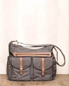 - DESCRIPTION - DETAILS Don't sacrifice style for function. Our versatile Rambler Satchel is the perfect organizer bag to keep your essentials stylishly stowed and well ordered. - protective iPad pock