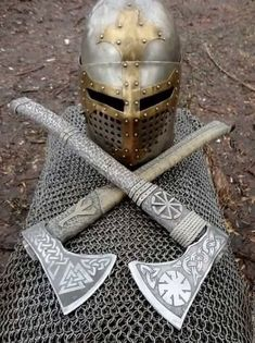 Two ancient axes and a helm discovered in Orgrirholmic ruins. Runes indicate that these belonged to the demigod Aldvif Gaedison. Swords And Daggers, Knives And Swords, Arte Ninja, Viking Axe, Viking Sword, Viking Helmet, Battle Axe, Medieval Weapons, Arm Armor